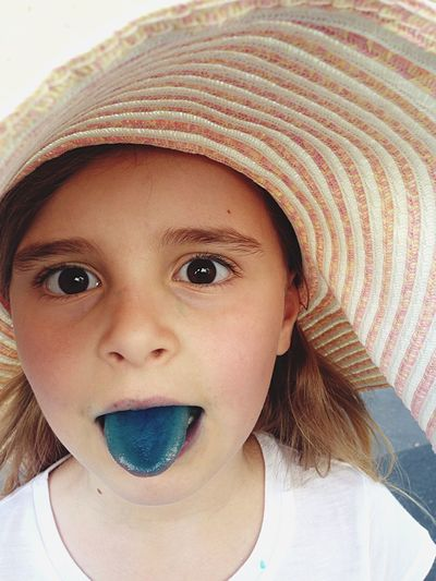 Blue The Portraitist - 2015 EyeEm Awards Color Portrait Portrait Girl Hat Blue Tongue Bigeyes