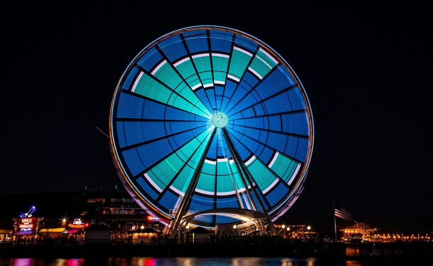 The seattle Great Wheel Ferris Wheel Circle Nightlife Travel Destinations Built Structure Architecture Concentric Cityscape Urban Skyline No People City EyeEm Selects PNWonderland Pnwexplored Upperleftusa SeattleLife Seattlephotographer City Life