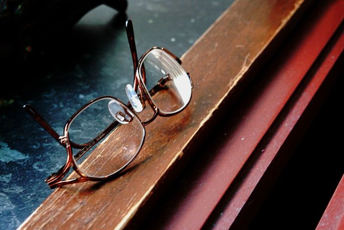 Clear Glass Clear Vision  Close-up Day Eyeglasses  Glasses Indoors  No People Table Wood - Material