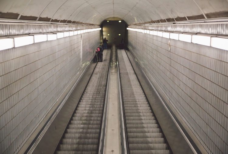 High Angle View Of Illuminated Escalator In Subway Station