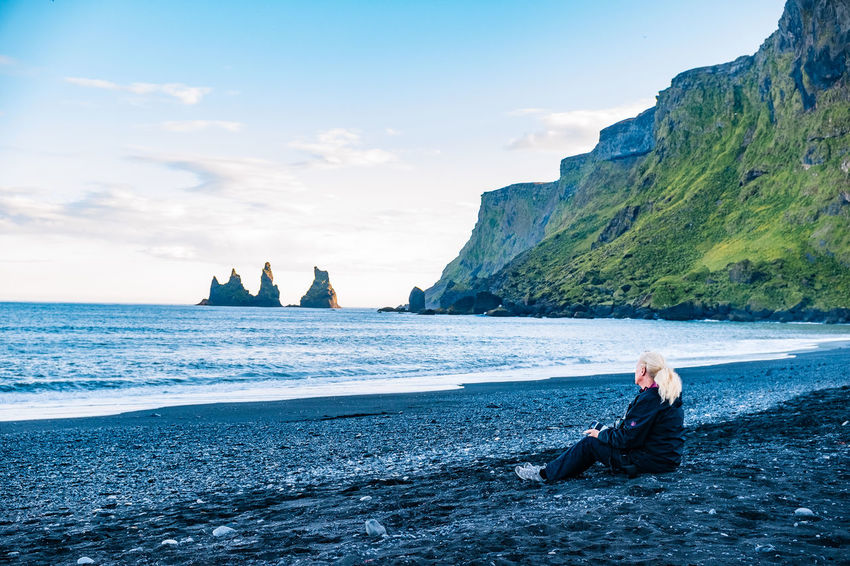 Adult Adults Only Beach Beauty In Nature Cliff Day Full Length Horizon Over Water Iceland Nature One Person One Woman Only Outdoors People Real People Rock - Object Scenics Sea Sitting Sky Tranquility Water Women Young Adult