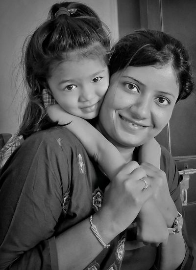 Portrait of happy mom and girl