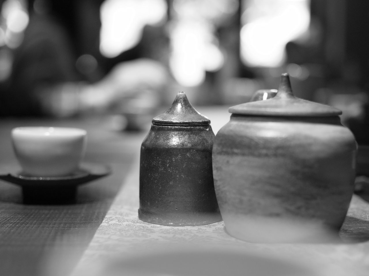 table, selective focus, close-up, indoors, no people, still life, food and drink, focus on foreground, teapot, group of objects, mug, candle, cup, tea, drink, hot drink, food, day, container, arrangement, crockery, tea cup