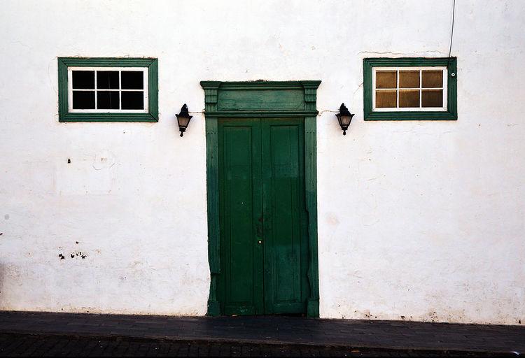 Closed Door And Window Of Building