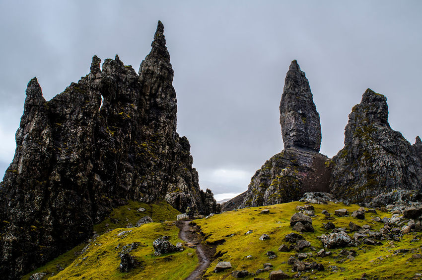 Old Man of Storr, Isle of Skye, Scotland Beauty In Nature Cloud - Sky Day Geology Green Color Hiking Isle Of Skye Landscape Mountain Nature Non-urban Scene Oldmanofstorr Outdoors Rock Rock - Object Rock Formation Rocky Mountains Scenics Scotland Sightseeing Sky Skye Tranquility Travel Wanderlust