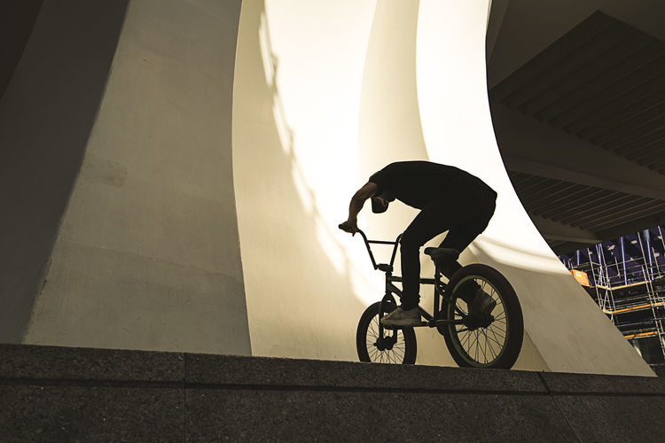 Low angle view of bicycle on street against building