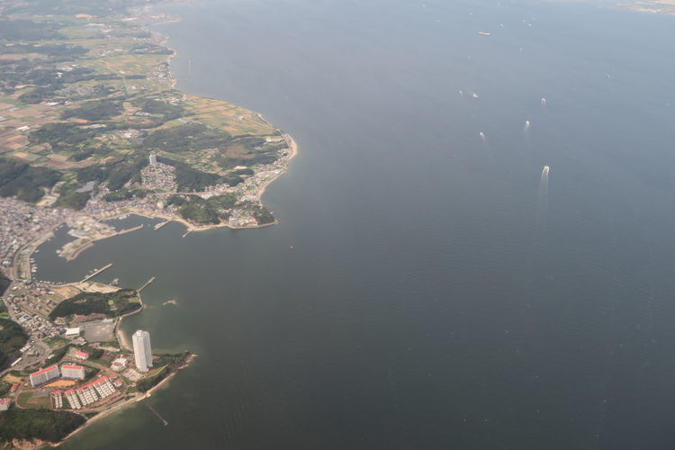 High Angle View Of Sea And Buildings In City