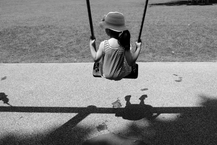 Rear view of a girl on swing