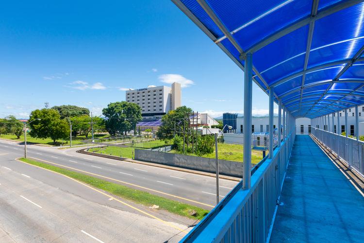 View of modern buildings against blue sky