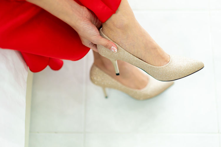 Wedding Ceremony bride wearing heels Wedding Wedding Shoes Weddings Around The World Adult Body Part Bride Bride Getting Ready Bride1 Close-up Fashion Hand High Heels Human Body Part Human Foot Human Hand Human Leg Indoors  Low Section Nail One Person Real People Red Shoe Standing Women