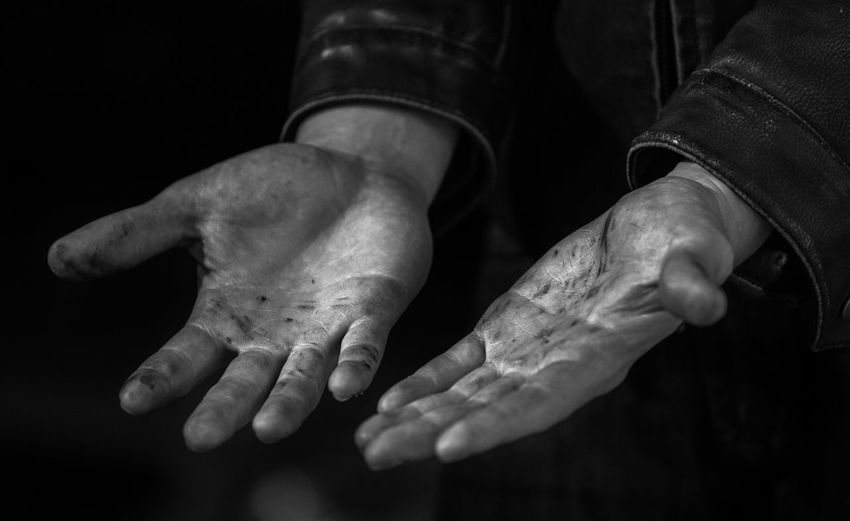 Midsection of man hand against black background