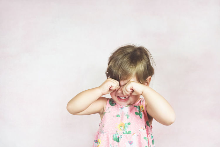 Childhood Child Innocence Girls Front View One Person Cute Indoors  Smiling Emotion Happiness Females Portrait Casual Clothing Looking At Camera Standing Women Copy Space Floral Pattern Angry Crying Crying Child Sad Toddler  Kid
