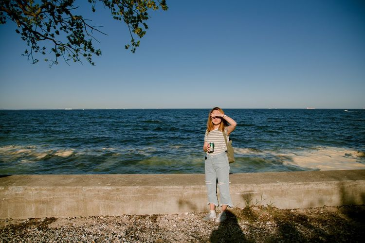 Golden Hour Sea Water One Person Standing Sky Full Length Real People Horizon Over Water Horizon Beach Leisure Activity Nature Scenics - Nature Beauty In Nature Day Outdoors Women Sunlight