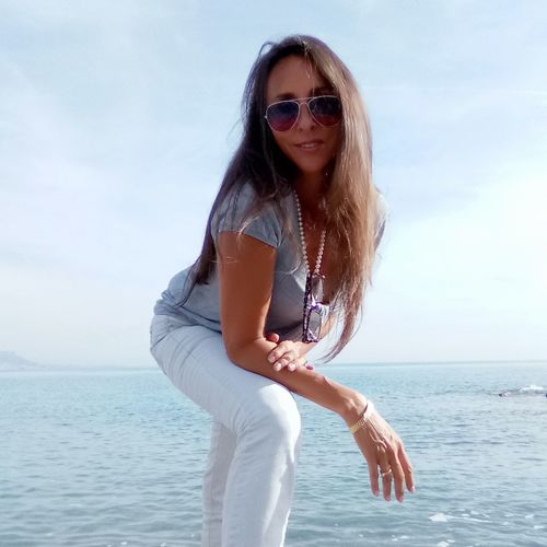 EyeEm Selects Sunglasses Long Hair One Woman Only Only Women One Person Young Adult Water Fashion Adults Only Portrait People Adult Summer Beautiful Woman Sea Smiling Young Women Beauty Sky Beautiful People first eyeem photo