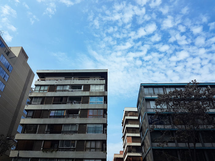 Building Exterior Architecture Built Structure Low Angle View City Sky And Clouds Blue Building Window Cloud Sky Outdoors Day Building Story Apartment Old Buildings Colours Colors Building And Sky Buildings Walking Around Samsung S7
