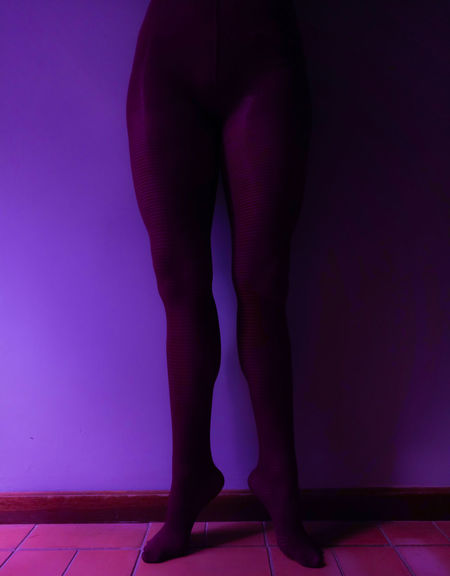 Woman`s legs wearing purple stockings with Pointed feet Ballerina Pointed Feet Slim Adult Barefoot Close-up Day Human Body Part Human Leg Indoors  Legs Low Section One Person One Woman Only One Young Woman Only Only Women People Purple Purple Background Purple Color Standing Studio Shot Woman Legs Young Adult