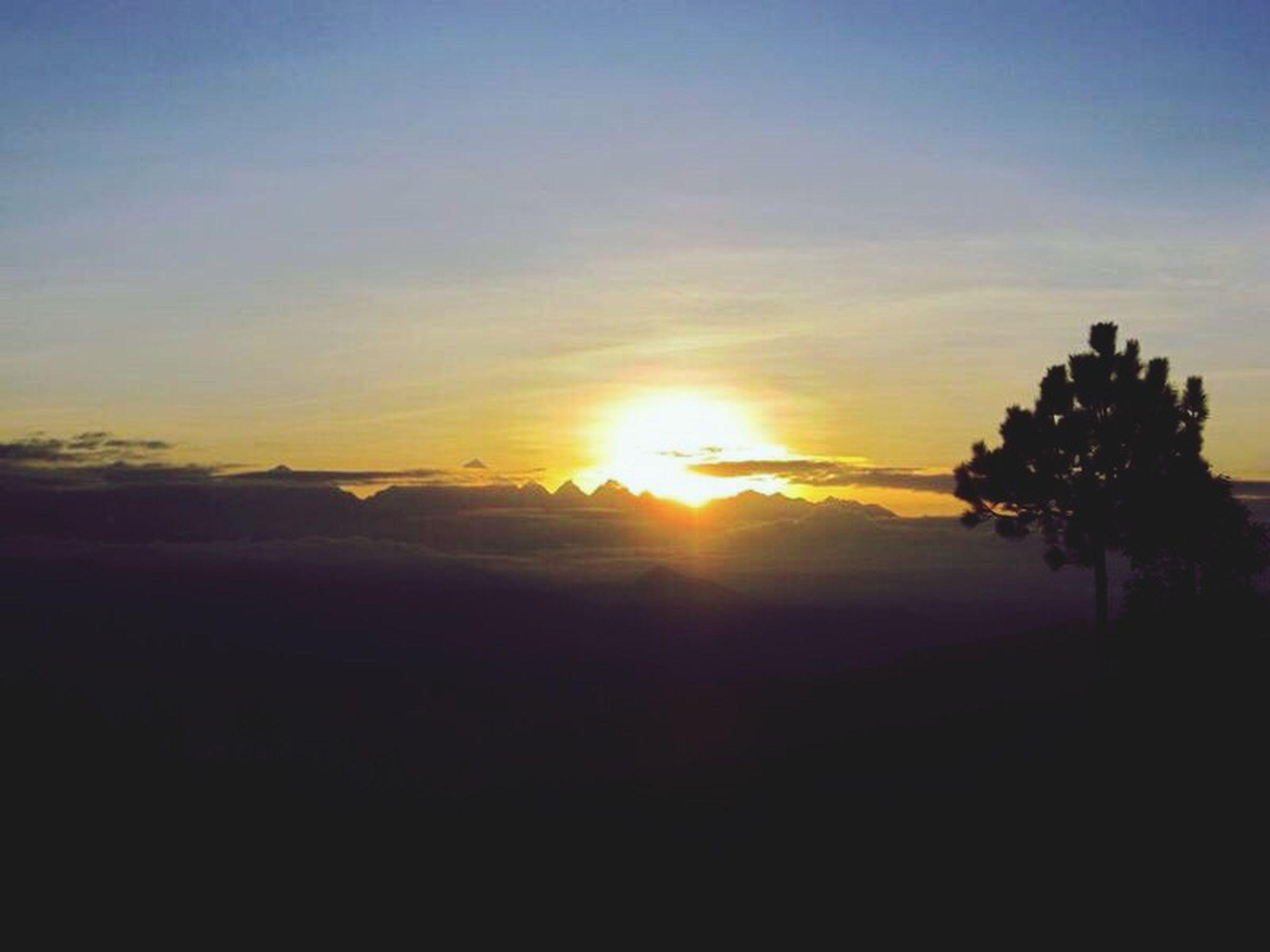sunset, sun, tranquil scene, scenics, silhouette, tranquility, beauty in nature, sky, orange color, idyllic, nature, sunlight, landscape, sunbeam, tree, cloud - sky, outdoors, non-urban scene, mountain, no people