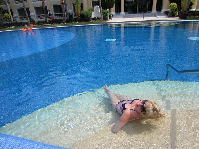 High Angle View Of Sensuous Woman Wearing Bikini In Swimming Pool