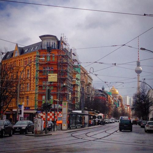 Architecture Berlin Berlin Mitte Building Built Structure Cable City City Life City Street Cloud Cloud - Sky Cloudy Day Junction Mode Of Transport Outdoors Platz Power Line  Residential Building Road Road Sky Street Light The Way Forward