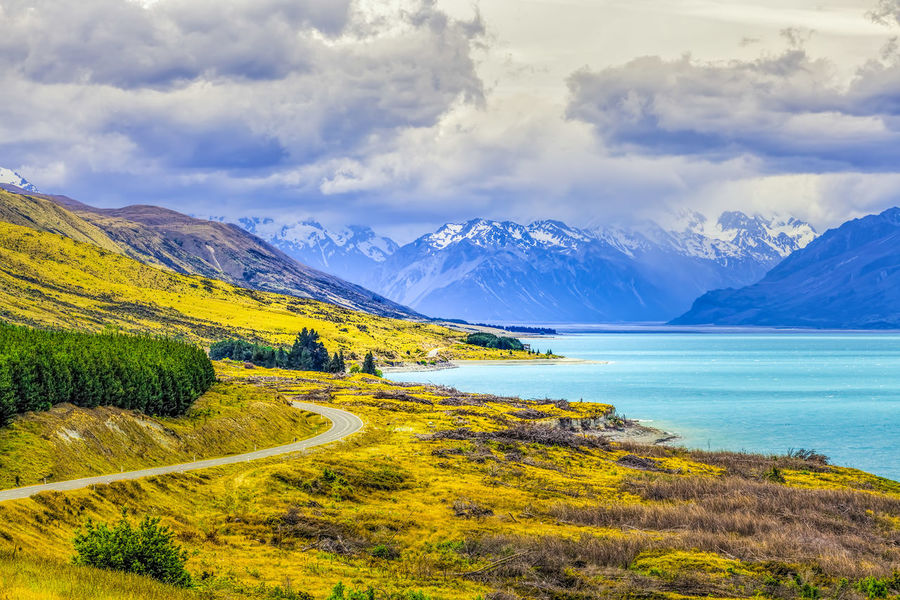 Lake Pukaki and Southern Alps, Canterbury, South Island, New Zealand Beauty In Nature Cloud - Sky Cold Temperature Day Grass Landscape Mountain Mountain Range Nature New Zealand New Zealand Landscape New Zealand Scenery No People Outdoors River Scenics Sky Tranquil Scene Tranquility Water Winter