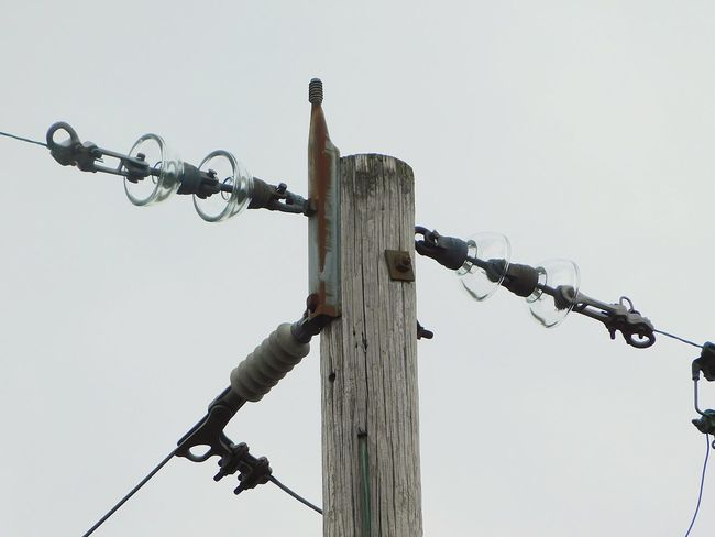 Electric Pole Electric Wire Weathered Rural Scene Close-up Sky Day Outdoors No People
