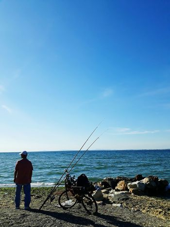Sea Horizon Over Water Silhouette Tranquil Scene Fishing Fishing Tackle Clear Sky Outdoors Summer Checkthis Out Places I've Been Today Dramatic Sky Taking Pictures Takingphotos Taking Photos Scenics Silhouette Second Acts Going Remote