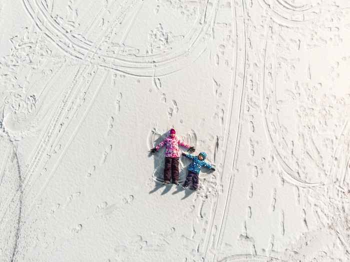 High angle view of umbrella on snow covered land