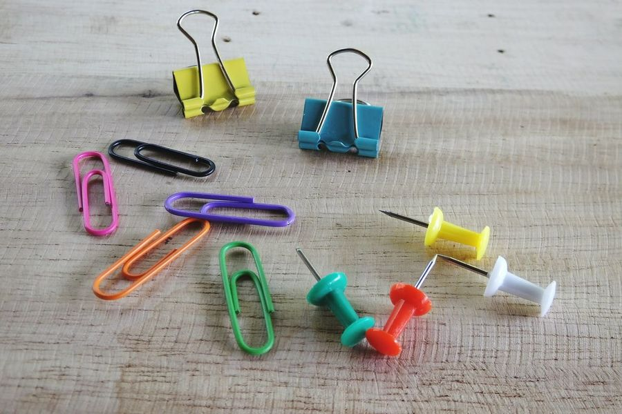 Wood Background Push Pins Multi Colored Paper Clip Variation High Angle View No People Large Group Of Objects Indoors