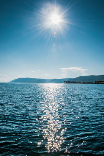 Sunrise on Baykal Baykal Travel Beauty In Nature Blue Bright Day Follow Idyllic Lens Flare Like Nature No People Outdoors Rippled Scenics - Nature Sea Sky Sun Sunbeam Sunlight Sunny Tranquil Scene Tranquility Water Waterfront