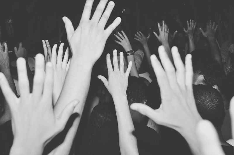 Crowd Waving Hands At Concert