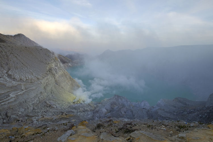 View of the Ijen crater filled with sulfur smoke Mountain Beauty In Nature Geology Landscape Smoke - Physical Structure Volcano Erupting Land Rock Nature Sky Cloud - Sky Environment Physical Geography Outdoors Volcanic Crater Scenics - Nature Mountain Range Ijen Ijen Crater Banyuwangi East Java Sulfur  Travel Destinations Tourism