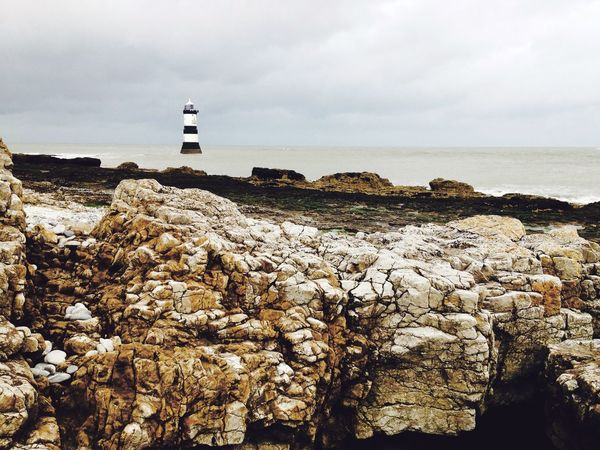 Beauty In Nature Calm Cliff Coastline Horizon Over Water Lighthouse No People Outdoors Rock - Object Rock Formation Scenics Sea Shore Sky Tranquil Scene Tranquility Water Puffin Island Anglesey Trwyn Du Black Nose