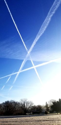 Scenic view of vapor trails in sky