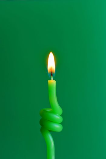 EyeEm Selects Flame Burning Fire Green Color Candle Illuminated Close-up Studio Shot Glowing Fire - Natural Phenomenon Heat - Temperature Lighting Equipment Wax No People Colored Background Indoors  Nature Copy Space Cut Out Single Object