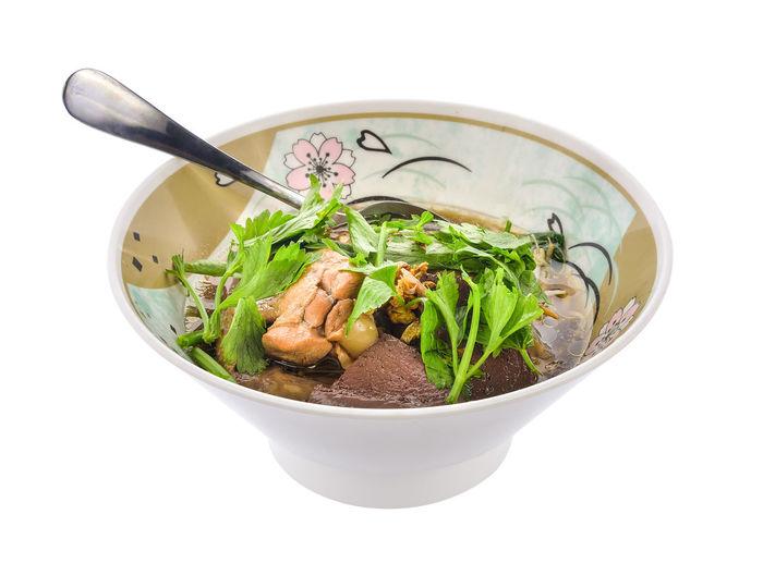 Vegetables in bowl against white background