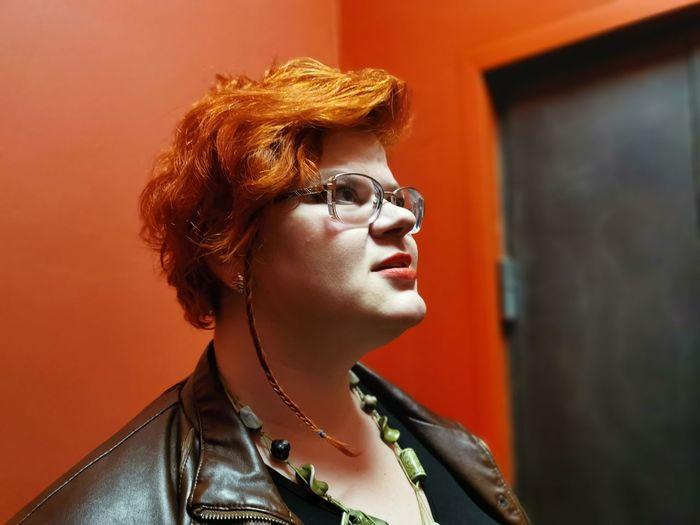 Redhead woman looking away at home