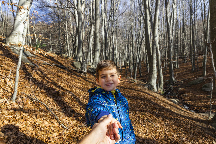 Child in autumn Tree Looking At Camera Portrait One Person Childhood Forest Plant Child Land Smiling Nature Bare Tree Day Front View Real People Boys Happiness Casual Clothing Offspring WoodLand Outdoors Innocence Hairstyle