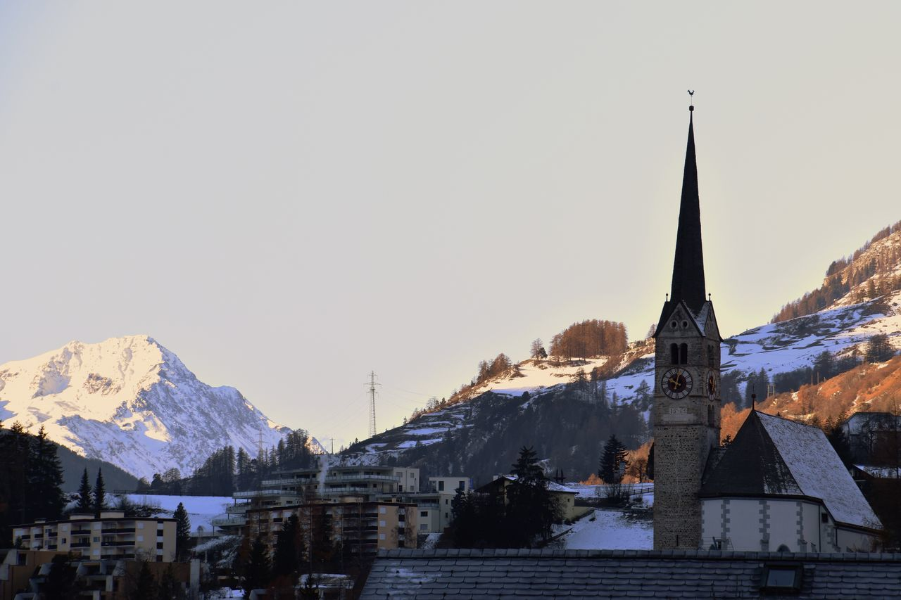 mountain, snow, architecture, building exterior, religion, place of worship, built structure, spirituality, cold temperature, mountain range, winter, nature, clear sky, copy space, outdoors, no people, day, snowcapped mountain, sky, travel destinations, scenics, beauty in nature