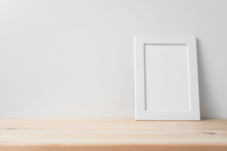 White wooden table against wall at home