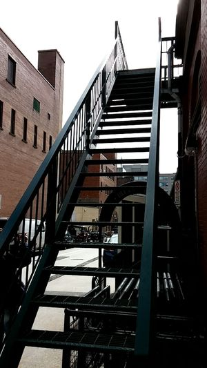 Architecture Black Iron Stairs Black Iron Steps Building Exterior Built Structure Clear Sky Day Fire Escape Low Angle View No Filter, No Edit, Just Photography No People Outdoors Railing Sky Staircase Steps Steps And Staircases