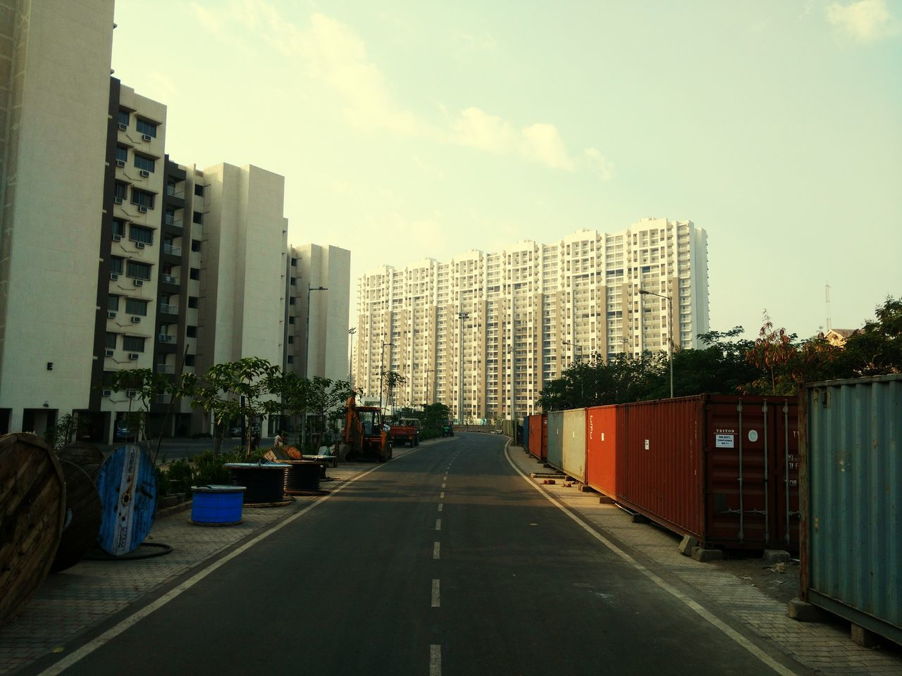 Empty Road With Buildings In Background