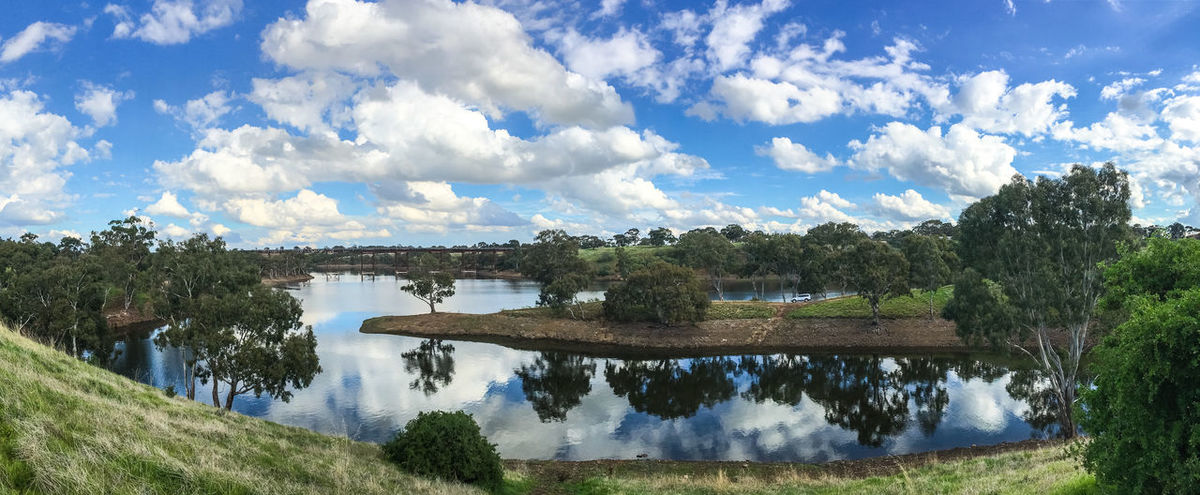 View of Melton Reservoir Mirror Reflection Beauty In Nature Blue Bridge - Man Made Structure Cloud - Sky Day Lake Melton Nature No People Outdoors Rail Railroad Railroad Bridge Reflection Reservoir Scenics Sky Tranquil Scene Tranquility Tree Water