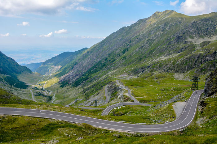 A view of the Transfagarasan road in Sibiu, Romania Beauty In Nature Cloud - Sky Curve Day Europe High Angle View Landscape Mountain Mountain Range Mountain Road Nature No People Non-urban Scene Outdoors Road Romania Scenics Sky Tranquil Scene Tranquility Transfagaraşan Transportation Winding Road