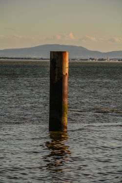 Sky Water Post Waterfront No People Nature Wood - Material Wooden Post Tranquility Tranquil Scene Day Lake Beauty In Nature Scenics - Nature Pole Outdoors Cloud - Sky Metal Architectural Column