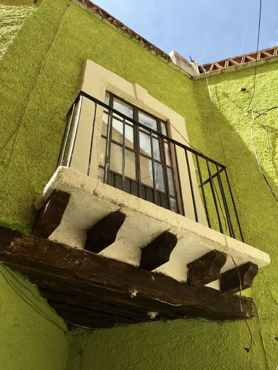 The window Architecture Built Structure Window Building Exterior Building Day Sunlight Shadow House Railing Wall - Building Feature Sky Low Angle View No People This Is Latin America