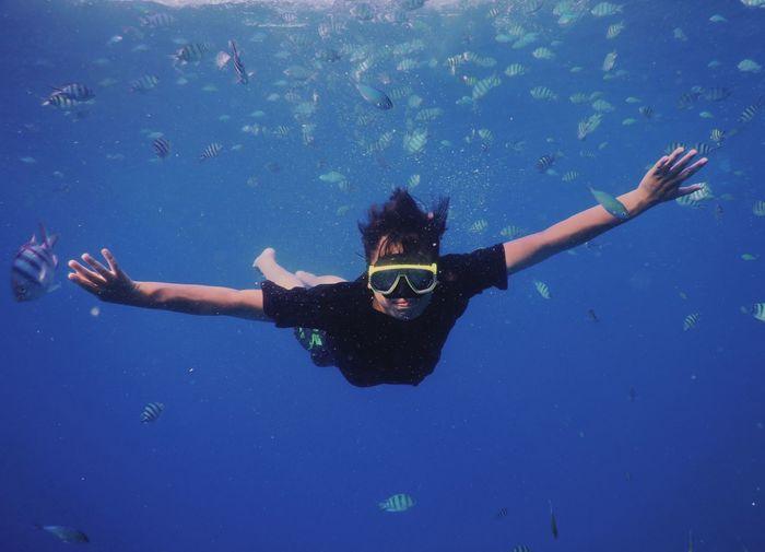 Portrait of man swimming under sea