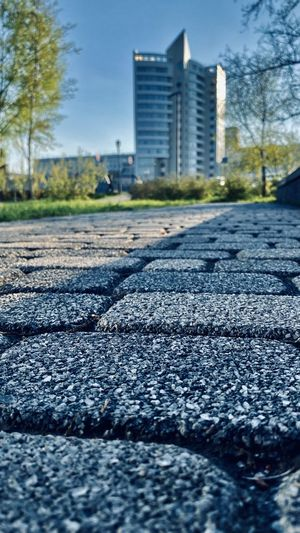 Surface level of road against buildings in city