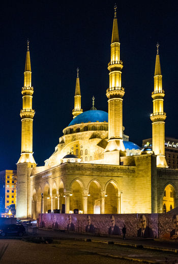 Arch Architectural Feature Architecture Beirut Building Exterior Built Structure Dome Exterior Façade Famous Place History Illuminated Mohammad Al-Amin Mosque, Beirut Monument Mosque Night Outdoors Person Place Of Worship Religion Spire  Spirituality Tall - High Tower Travel Destinations