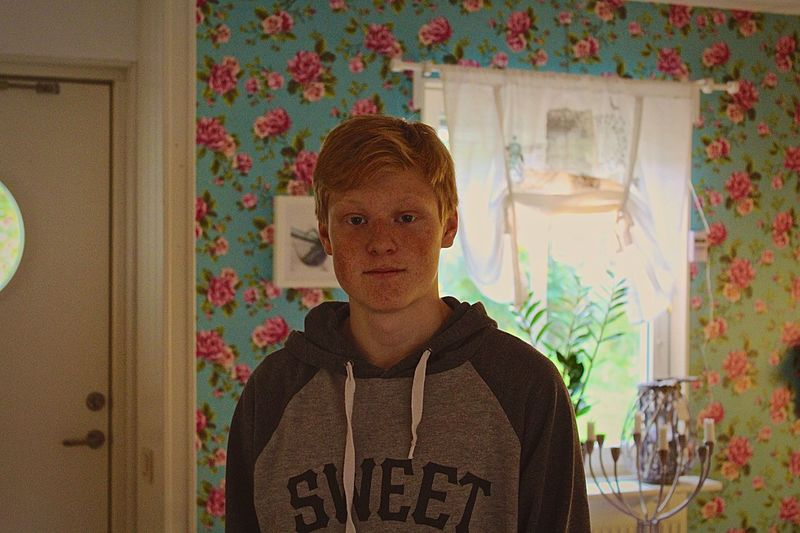 Brother Indoors  Lifestyles Waist Up Front View Leisure Activity Casual Clothing Focus On Foreground Looking At Camera In Front Of Young Adult Domestic Life Full Frame Day Selective Focus Brown Indoors  Boy Boys BoysBoysBoys Ginger Gingerhair Turquoise Flowers Wall Kitchen