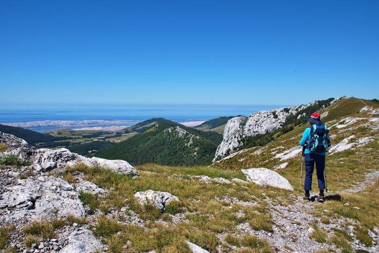 Senior woman hiking in velebit mountain, croatia